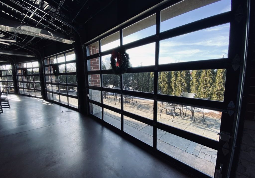 Interior view of glass overhead garage doors from our lemont, il job site.